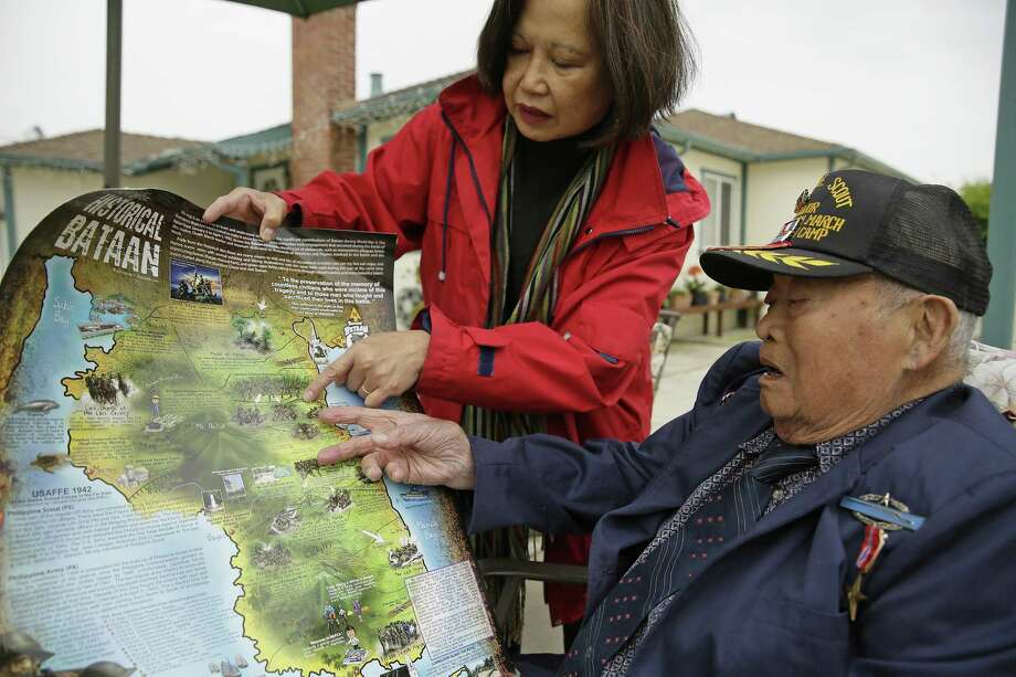 With Cecilia Gaerlan at his home in El Cerrito, Calif., Bataan Death March survivor Ramon Regalado looks at a map showing the route where thousands died as prisoners of Japan. Photo: Eric Risberg / Associated Press / Copyright 2017 The Associated Press. All rights reserved.