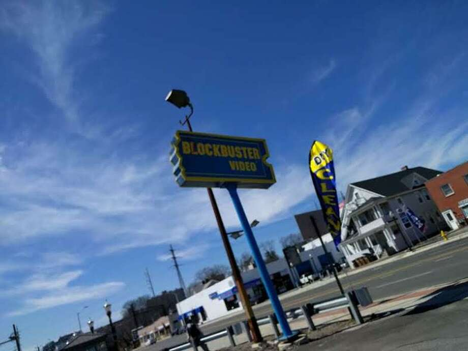 A holdover from the 90s: The Blockbuster Video sign at 953 East Main St. in Stamford. Photo: Joshua Fisher / Contributed
