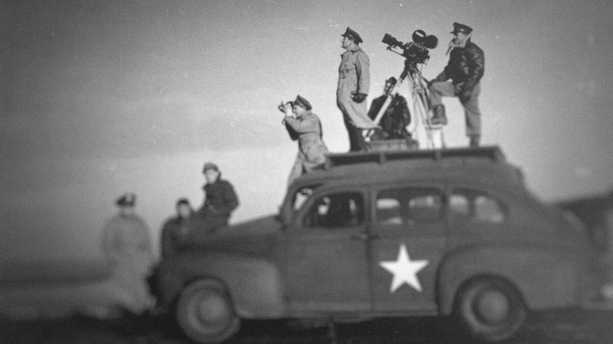 Director John Ford shoots World War II propaganda in the series