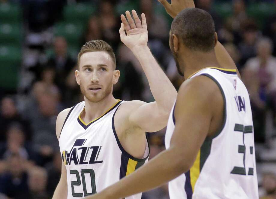 Utah Jazz's Gordon Hayward receives a high-five from teammate Boris Diaw (33) after scoring against the Portland Trail Blazers during the second half on April 4, 2017, in Salt Lake City. The Jazz won 106-87. Photo: Rick Bowmer /Associated Press / Copyright 2017 The Associated Press. All rights reserved.