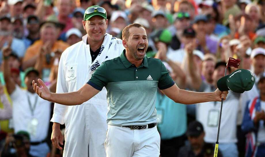 Sergio Garcia celebrates winning the Masters on April 9, 2017 at Augusta National Golf Club. Garcia defeated Justin Rose in a playoff. Looking on is Garcia's caddie, Glen Murray. Photo: Jeff Siner /Charlotte (N.C.) Observer / Stratford Booster Club