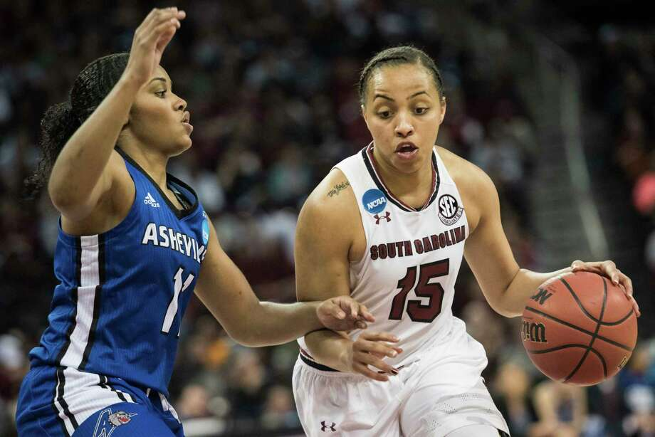South Carolina guard Tiffany Davis (15) dribbles around North Carolina Asheville guard Khaila Webb (11) during a first-round game in the women's NCAA college basketball tournament Friday, March 17, 2017, in Columbia, S.C. South Carolina defeated UNC Asheville 90-40. Photo: Sean Rayford, FRE / The Associated Press