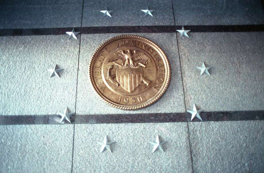 10/26/1990 - A medallion decorates the new $300 million Houston Veterans Affairs Medical Center to be dedicated today. The facility will not go into operation until the spring and replaces the adjacent existing facility opened as a naval hospital in 1946. Photo: Larry Reese, HC Staff / Houston Chronicle / Houston Chronicle
