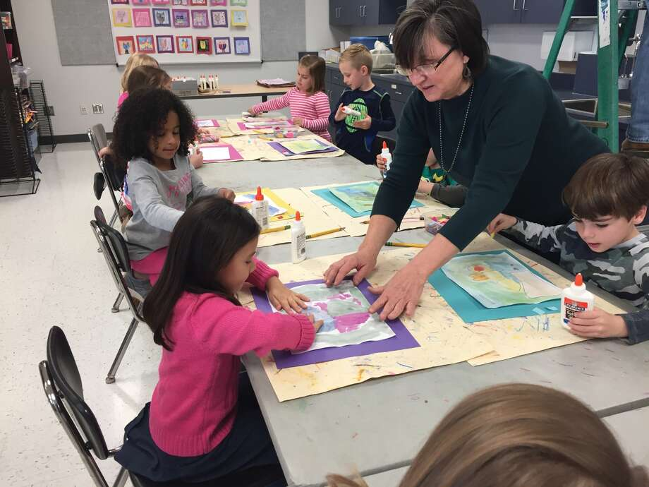 Art teacher Sandy Fultz assists Goshen Elementary students with their project. Those students are Mecca Cross, in gray, Rae Dombrowski in pink and Bennett Baird, at right. Photo: Julia Biggs • Intelligencer