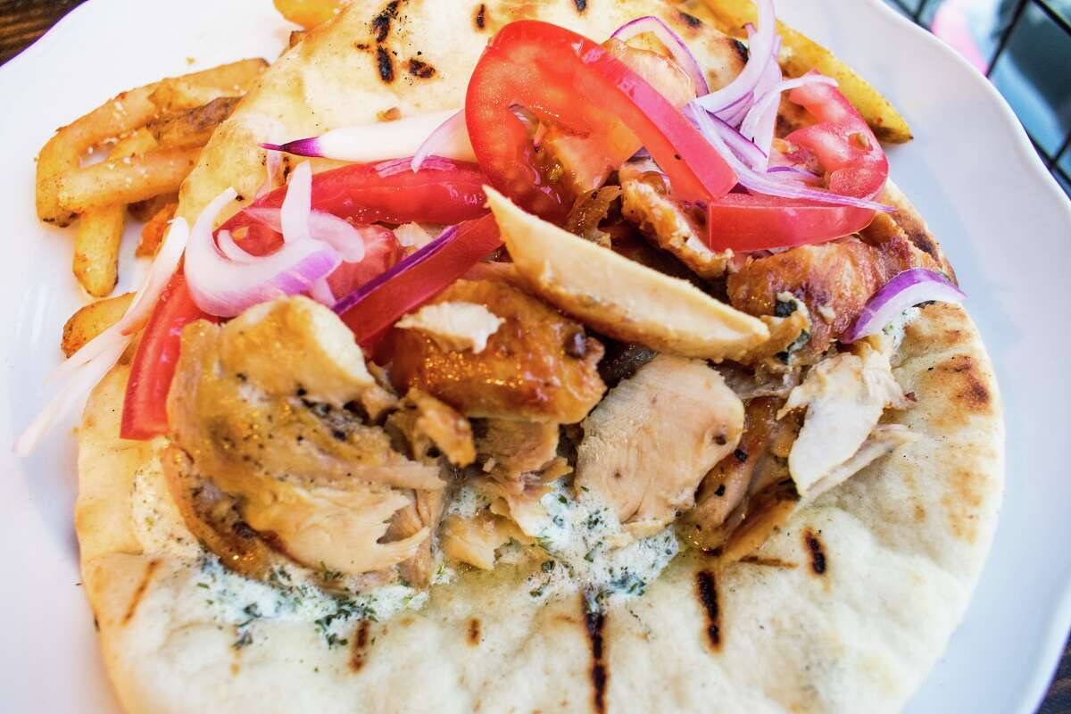 Helen in the Heights, a new restaurant from the owners of Helen Greek Food and Wine, will open at 1111 Studewood on April 11. It takes over the space of the former Arthur Avenue Italian American, which closed in April. The new restaurant is a casual Greek taverna. Shown: Feta-brined chicken gyro.