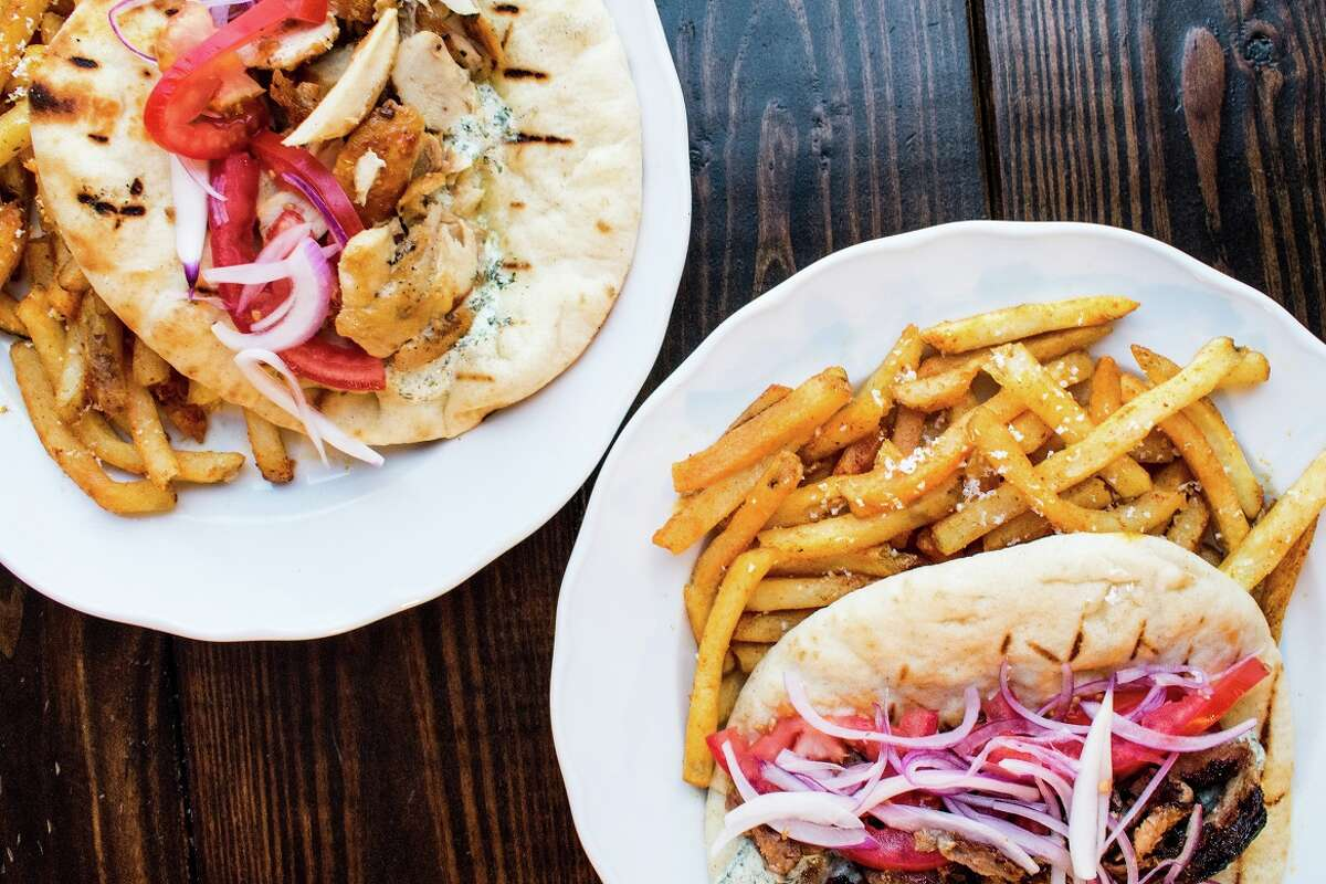 Helen in the Heights, a new restaurant from the owners of Helen Greek Food and Wine, will open at 1111 Studewood on April 11. It takes over the space of the former Arthur Avenue Italian American, which closed in April. The new restaurant is a casual Greek taverna. Shown: Feta-brined chicken and lamb gyro.