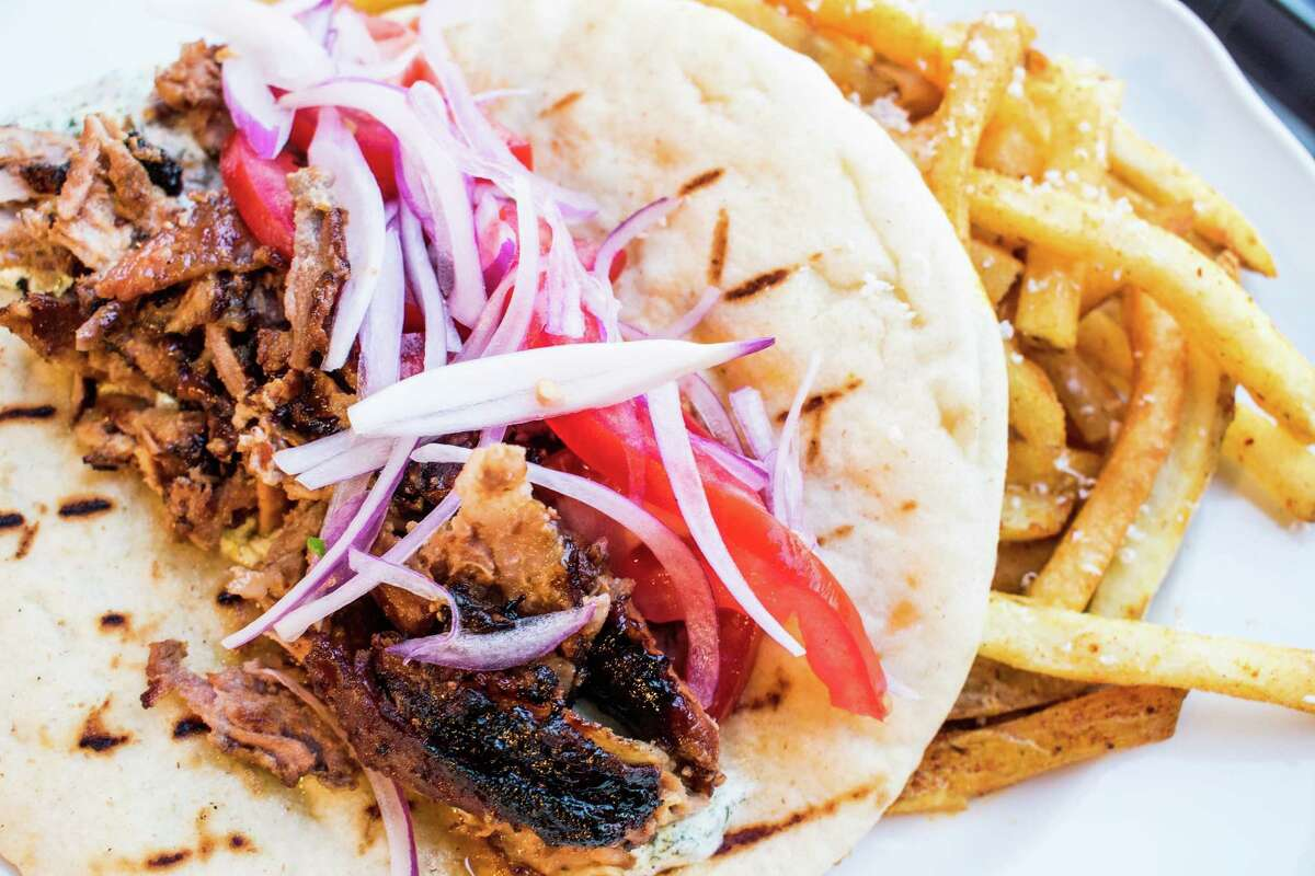 Helen in the Heights, a new restaurant from the owners of Helen Greek Food and Wine, will open at 1111 Studewood on April 11. It takes over the space of the former Arthur Avenue Italian American, which closed in April. The new restaurant is a casual Greek taverna. Shown: Classic pork gyro.
