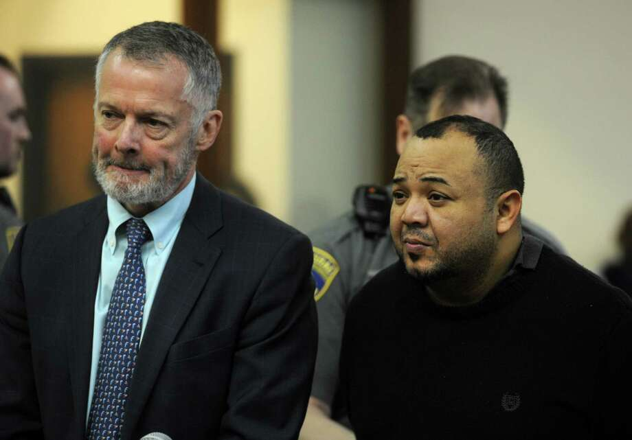 Oscar Hernandez, right, with his attorney John R. Gulash, faces Judge William Holden in Bridgeport Superior Court on Monday, April 10, 2017 in Bridgeport, Conn. Hernandez, 39, was arraigned on murder and kidnapping charges, his bond set at $2 million. Photo: Ned Gerard, Hearst Connecticut Media / Connecticut Post