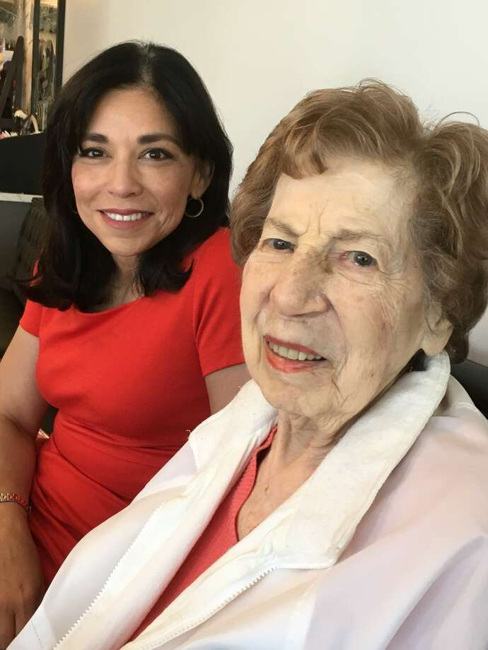 "Laura Jaramillo, an Holocaust Museum Houston board trustee, back, is paired with Holocaust survivor Ruth Brown through the museum's ""Connections"" program. Photo: Karen Zurawski"