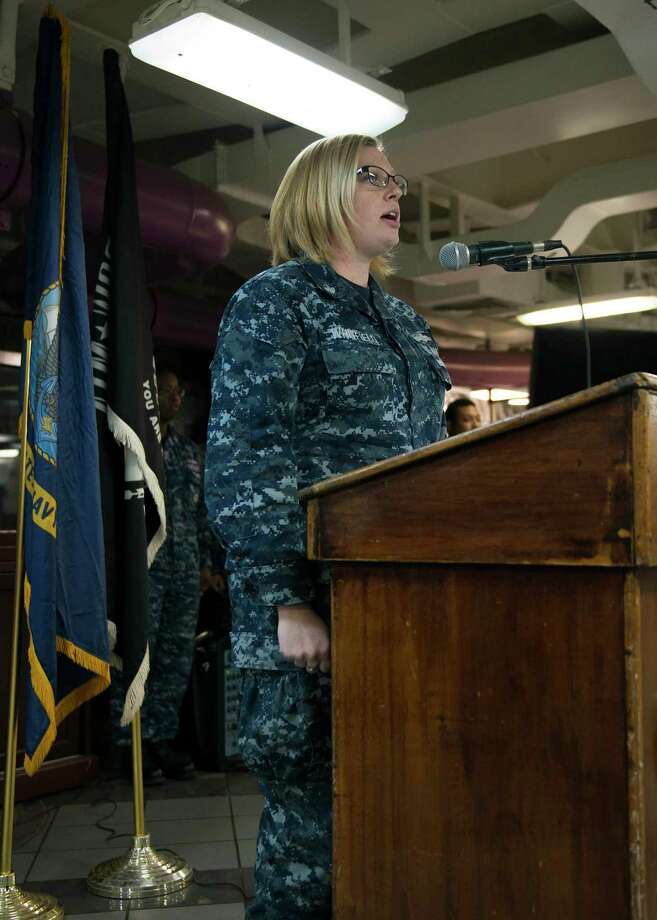 YOKOSUKA, Japan — March 23, 2017 — Information Systems Technician 2nd Class (SW/IW) Taylor Whitfield, from Katy, Texas, sings the national anthem during a Women's History Month ceremony aboard the Navy's only forward-deployed aircraft carrier, USS Ronald Reagan (CVN 76). In 1987 after being petitioned by the National Women's History Project, Congress designated March 1987 as the first Women's History Month. Ronald Reagan, the flagship of Carrier Strike Group 5, provides a combat-ready force that protects and defends the collective maritime interests of its allies and partners in the Indo-Asia-Pacific region. Photo: U.S. Navy Photo By Mass Communication Specialist Seaman Frank Joseph Speciale, USS Ronald Reagan (CVN 76) / Digital