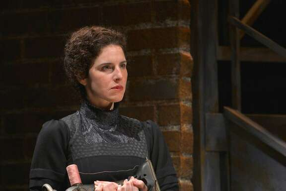 """Frustrated from her time in the sweatshop, Rebecca (Kyra Miller) grips her sewing machine in�TheatreWorks Silicon Valley's """"Rags."""""""