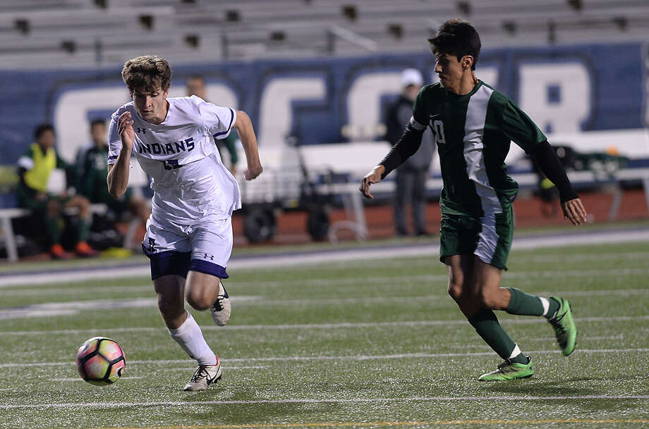 Port Neches - Groves' Preston Riggs looks to beat Livingston to the ball during their match-up at Port Neches Tuesday. The game marked the end of regular season play for the Indians, who took the field undefeated in District 22 - 5A. Photo taken Tuesday, March 14, 2017 Kim Brent/The Enterprise Photo: Kim Brent / BEN