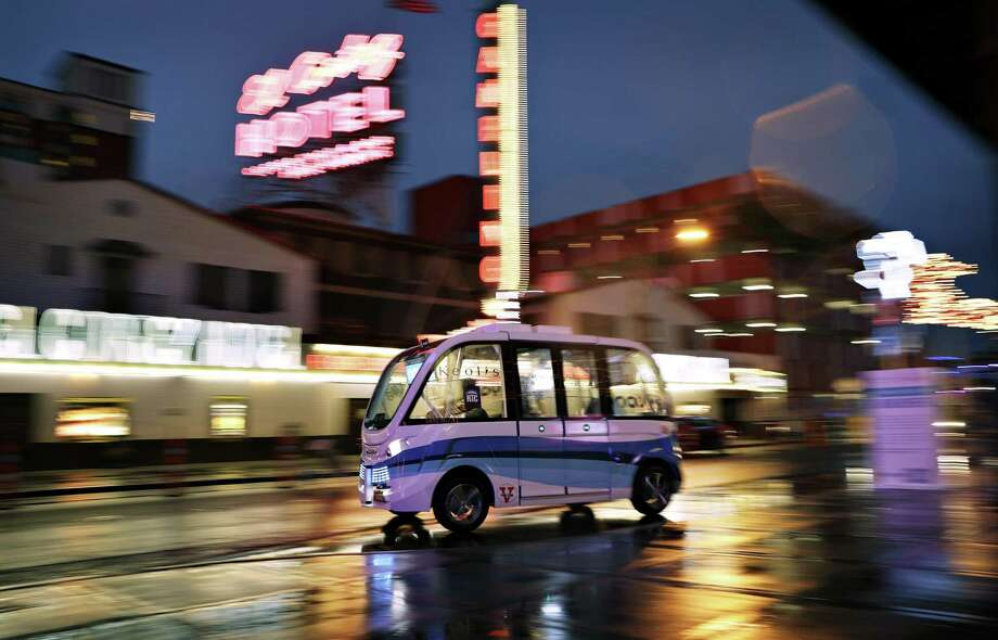 A Navya Arma autonomous vehicle drives down a street in Las Vegas. The driverless electric shuttle has begun carrying passengers in a test program in a downtown Las Vegas entertainment district. A convergence of three trends — ride sharing, autonomous driving and vehicle electrification — will drive a shift toward shared, self-driving electric cars, according to a study by the Boston Consulting Group. The change will be most profound in cities with more than 1 million people, where consumers will find it more economically advantageous to exit their personal vehicles and start hailing robot taxis. Photo: John Locher /Associated Press / Copyright 2017 The Associated Press. All rights reserved.