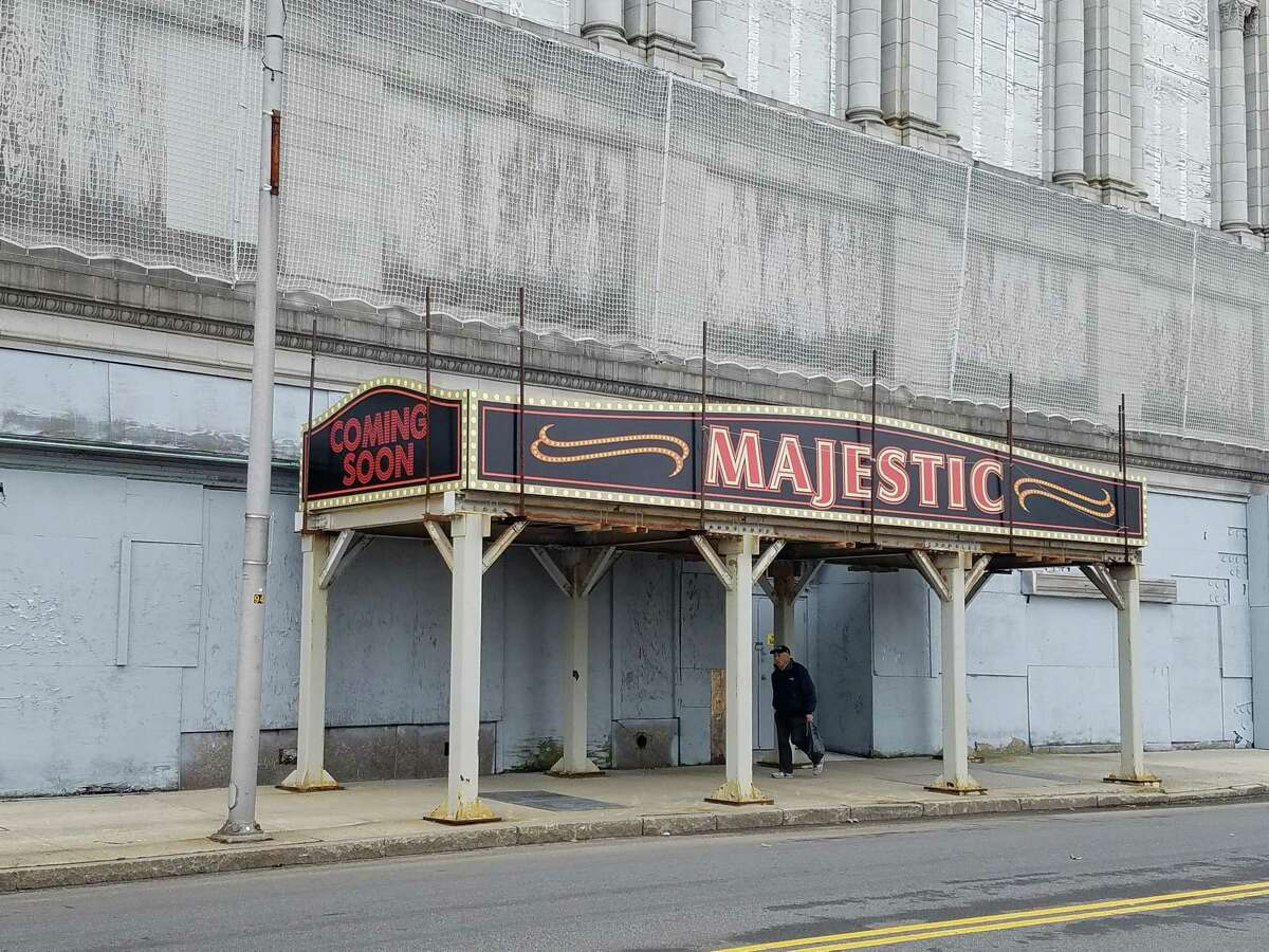 A man walks under the faux marquee the city has placedin front of thePoliPalaceandMajesticTheaterin anticipation of the announcement of the bidder chosen to revive the complex.