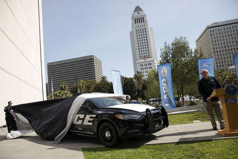 "Kevin Koswick, director of North American fleet lease and remarketing at Ford Motor Co., speaks as the company's new Police Responder hybrid vehicles are unveiled during an event outside of Los Angeles Police Department (LAPD) headquarters in Los Angeles, California, U.S., on Monday, April 10, 2017. Ford says its new Police Responder hybrid sedan, a modified Fusion, is the first gasoline-electric cop car to be ""pursuit-rated,"" meaning it can race through city streets while navigating crowded intersections or hopping curbs. Photographer: Patrick T. Fallon/Bloomberg Photo: Patrick T. Fallon, Bloomberg"