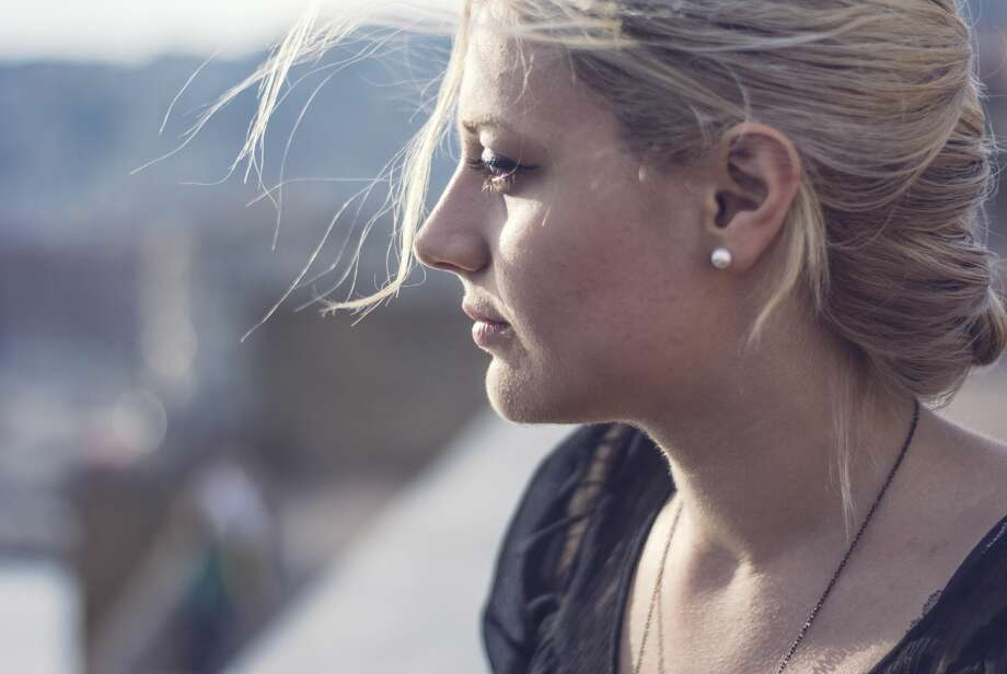 A young woman wonders if her long distance relationship is worth staying in. Photo: Valeria Schettino/Getty Images