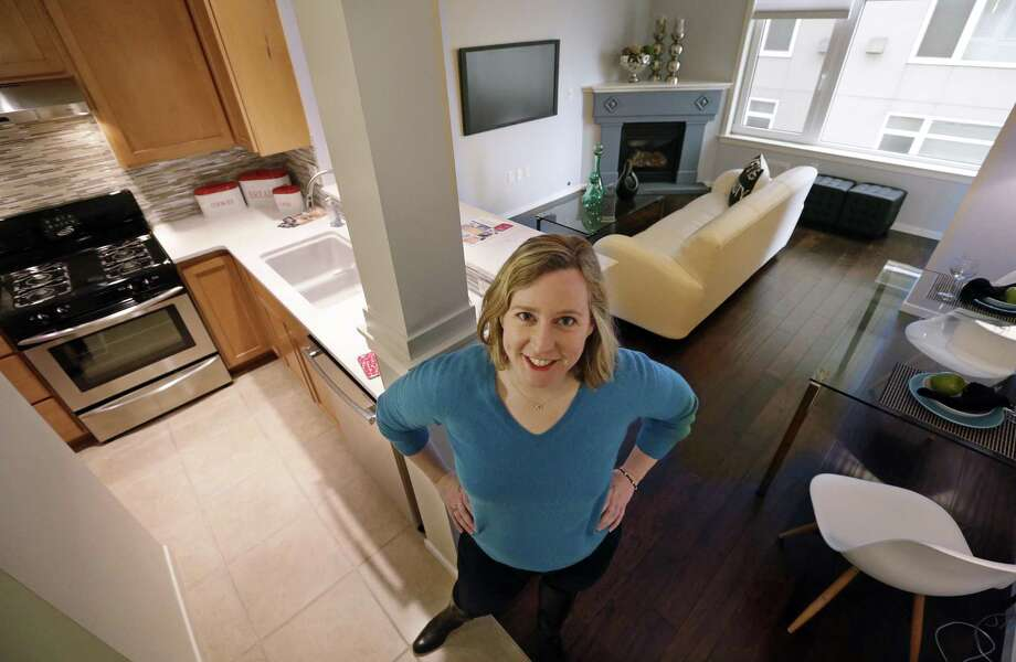 Kathleen Mulcahy stands in her recently sold one-bedroom condo, on which she received nearly two dozen offers and sold for more than $100,00 over her asking price, in Seattle's Belltown neighborhood. Photo: Elaine Thompson /Associated Press / Copyright 2017 The Associated Press. All rights reserved.