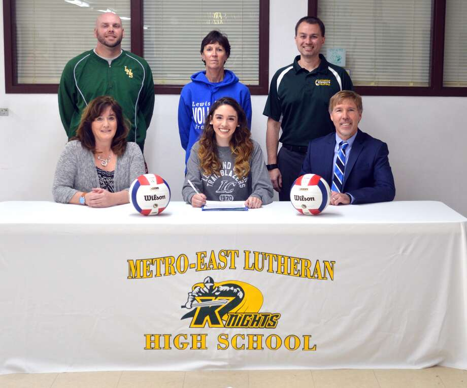 Metro-East Lutheran senior Lydia Flaherty will play volleyball at Lewis and Clark Community College. In the front row, from left to right, are mother Ashley Flaherty, Lydia Flaherty and father Kelly Flaherty. In the back row, from left to right, are MELHS athletic director Rob Stock, Lewis and Clark coach Johnna Kinney and MELHS coach Jon Giordano.