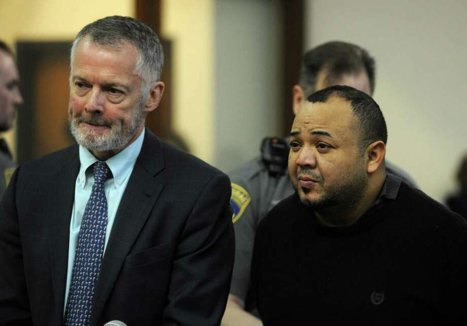 Oscar Hernandez, right, with his attorney John R. Gulash, faces Judge William Holden in Bridgeport Superior Court on Monday, April 10, 2017 in Bridgeport, Conn. Hernandez, 39, was arraigned on murder and kidnapping charges, his bond set at $2 million. Photo: Ned Gerard / Hearst Connecticut Media / Connecticut Post