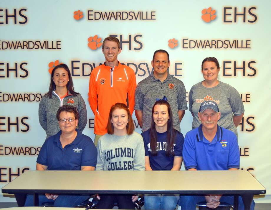 Edwardsville senior Victoria Vegher will compete in cross country and track and field at Columbia College. In the front row, from left to right, are mother Kim Vegher, Victoria Vegher, sister Brittany Dudley and father Dan Vegher. In the back row, from left to right, are EHS assistant cross country coach Maggie Dust, EHS assistant cross country coach and assistant girls' track and field coach Dustin Davis, EHS cross country coach George Patrylak and EHS girls' track and field coach Camilla Eberlin.