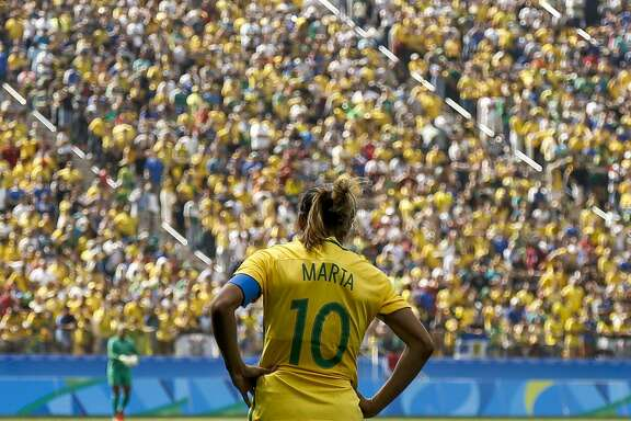 TOPSHOT - Brazil's player Marta reacts during their Rio 2016 Olympic Games women's bronze medal football match between Brazil vs Canada, at the Arena Corinthians Stadium in Sao Paulo, Brazil on August 19, 2016. / AFP / Miguel SCHINCARIOL        (Photo credit should read MIGUEL SCHINCARIOL/AFP/Getty Images)