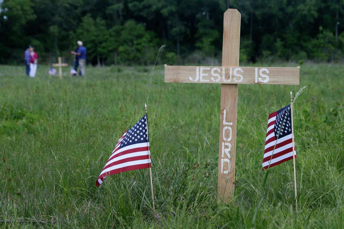 Relatives of those buried in the Aldine Cemetery placed a few crosses around the property.