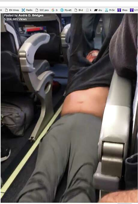 Security officers at Chicago's O'Hare Airport are seen dragging a United Airlines passenger down the aisle by his arms in this video taken by other passengers. Photo: Screen Shot