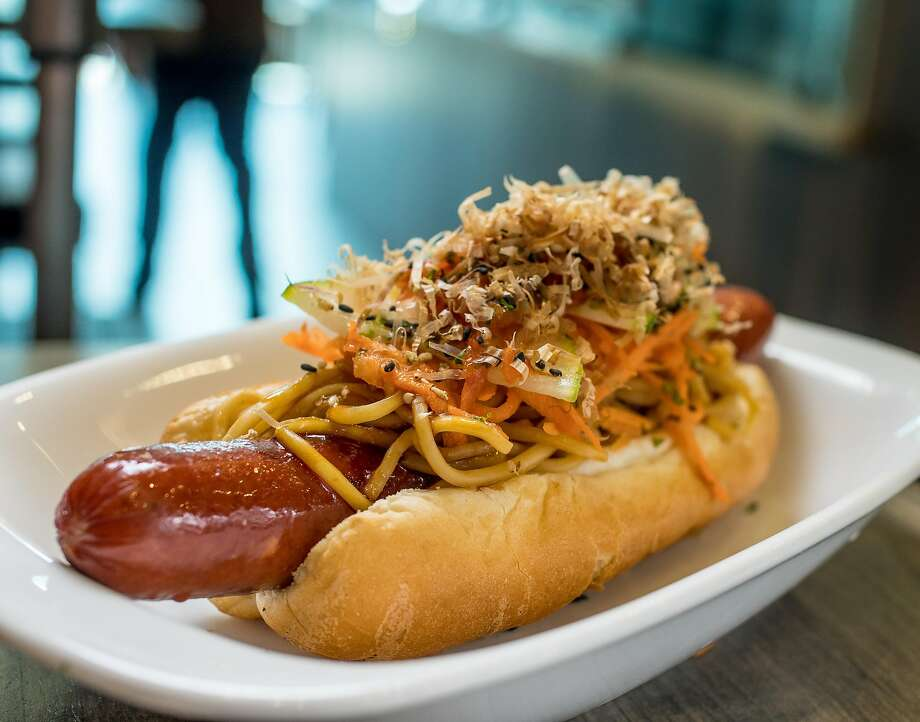 The Kimdle hot dog is topped with yakisoba noodles, a few sauces and layered with pickled carrots, cucumber and kimchi. Photo: John Storey, Special To The Chronicle