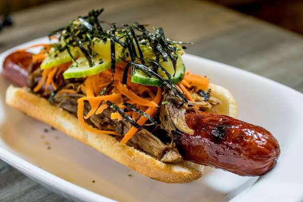 The Gyufire Hot Dog Takuya Japanese Hot Dog and Bowl topped with Beef and Pineapple in San Francisco, Calif. is seen on April 10th, 2017.