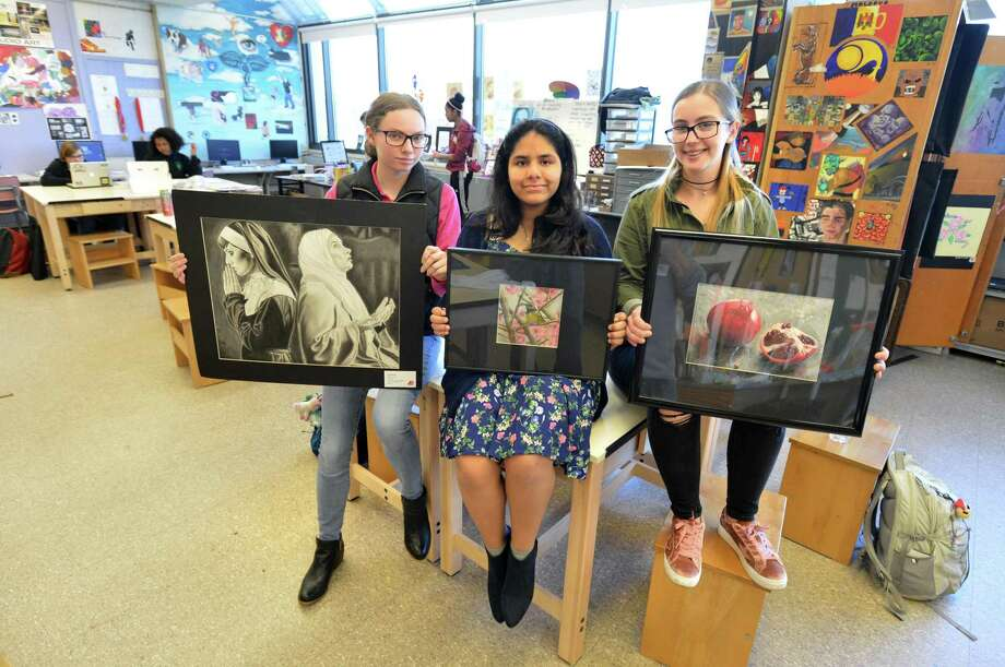 Norwalk High School students Megan Ruhnke, Kimberly Malaspina and Wiktoria Piktel win top prizes for their artwork in the annual Scholastic Art & Writing Awards. Showing their winning work in charcoal, mixed media and colored pencil in the art classroom at Norwalk High on Monday April 3, 2017 in Norwalk Conn. Photo: Alex Von Kleydorff / Hearst Connecticut Media / Norwalk Hour