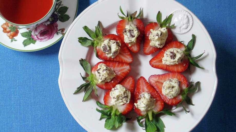 Italian Stuffed Strawberries combine sweet, juicy, fresh strawberries with tart Neufchatel or cream cheese. Photo: Sara Moulton, UGC / Sara Moulton
