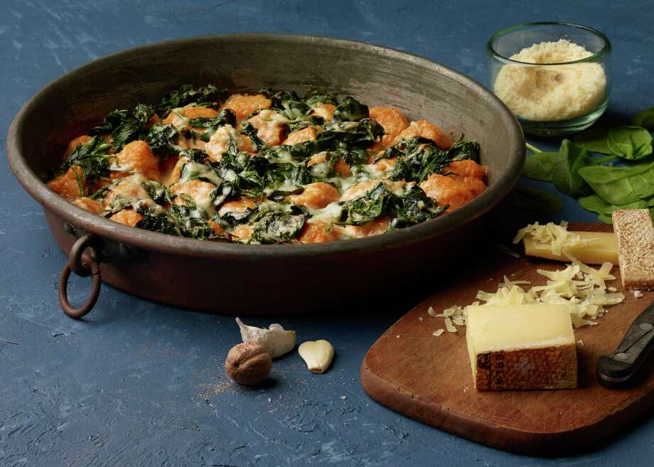 Sweet Potato Dumplings and Spinach Gratin are satisfying enough to take on the role of main dish. / For The Washington Post