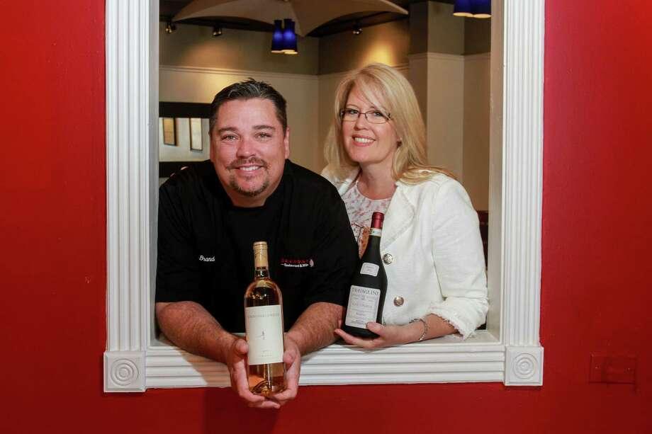 Ron and Claire Brandani, of Brandani's Restaurant & Wine Bar, recommend the 2011 Traveglini Gattinara Riserva. Photo: Gary Fountain, For The Chronicle / Copyright 2017 Gary Fountain