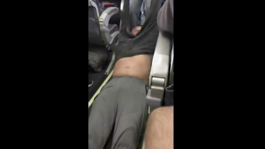 On Monday, the world became distracted by viral videos showing a United Airline passenger being violently dragged down a plane aisle so a crew member could take his seat. Shown is an image made from a video provided by Audra D. Bridges. Photo: Audra D. Bridges / Audra D. Bridges