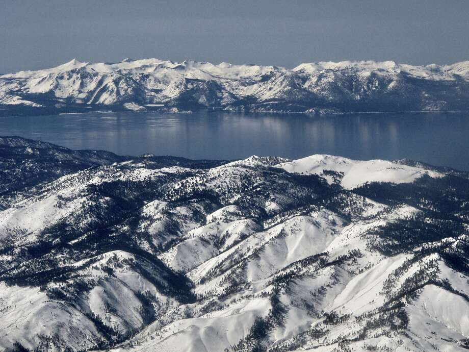 In this photo taken March 2, 2017, record winter snowfall is seen in the mountains around Lake Tahoe, in this aerial photo taken from above the Washoe Valley just south of Reno, Nev. Surveyors will crunch across the deepest mountain snowdrifts California has seen in years on Thursday, March 30, 2017, to take the first snow measurement of the spring, a time when the snow begins to melt and flow downhill. (AP Photo/Scott Sonner) Photo: Scott Sonner, Associated Press