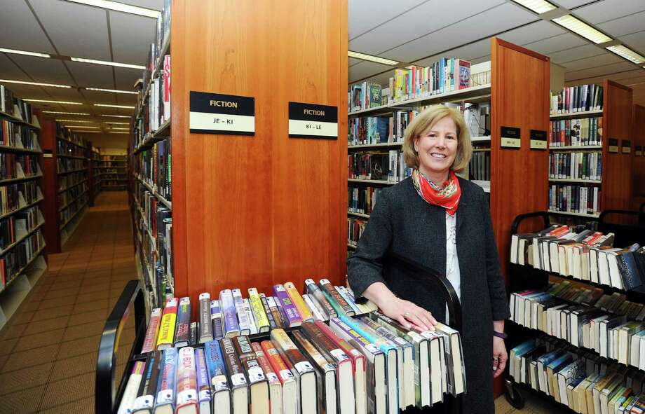 Ferguson Library President Alice Knapp poses for a photo inside the main branch of the library in downtown Stamford. Photo: Michael Cummo / Hearst Connecticut Media / Stamford Advocate