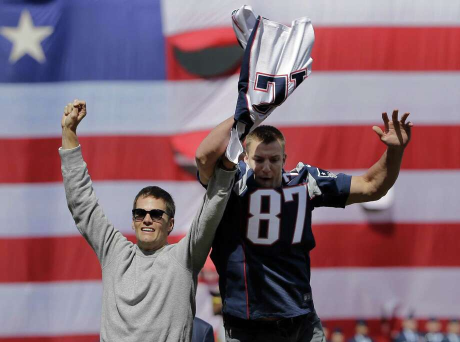 Clowning around during the Boston Red Sox opening day, New England Patriots tight End Rob Gronkowski (right) swoops in to grab a stolen — then recovered — jersey from teammate Tom Brady. A reader is amazed that so much energy was expended to recover the Super Bowl jersey. Photo: Elise Amendola /Associated Press / Copyright 2017 The Associated Press. All rights reserved.