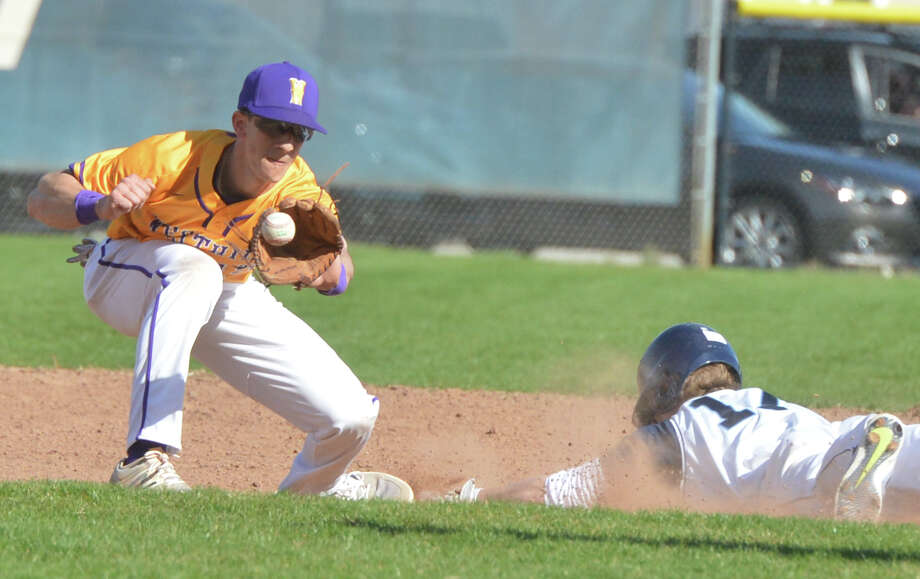 Weshill's #15 Dean DePreta makes the out against Wilton's # 17 Henry Strmecki at second base during baseball action on Monday April 10, 2017 at Witon High School Photo: Alex Von Kleydorff, Hearst Connecticut Media / Norwalk Hour