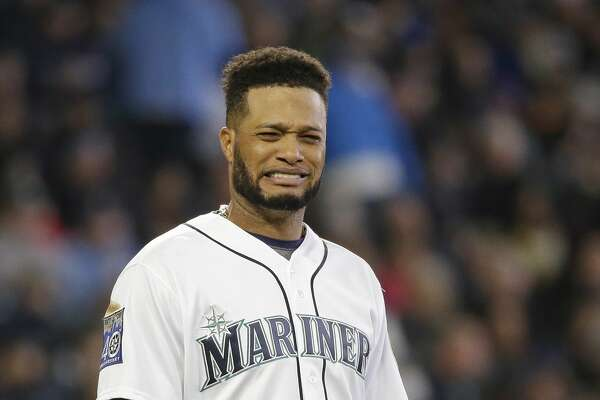 Seattle Mariners' Robinson Cano reacts after being left stranded during a bases-loaded fourth inning of a baseball game against the Houston Astros Monday, April 10, 2017, in Seattle. (AP Photo/Elaine Thompson)