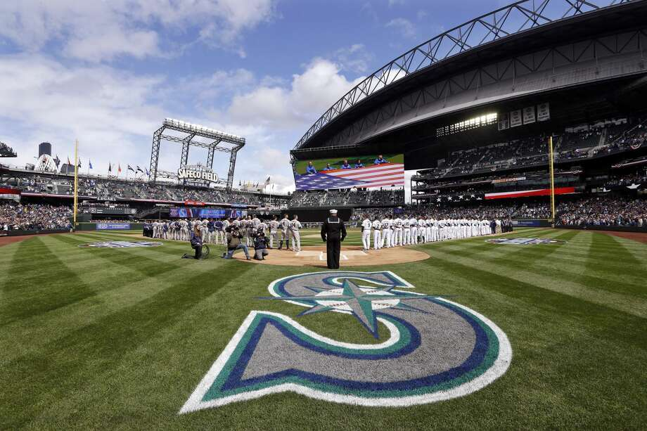 Retired Navy Petty Officer Generald Wilson stands at home to sing the national anthem before a baseball game as Seattle Mariners and Houston Astros players line-up, Monday, April 10, 2017, in Seattle. The game is the home opener for the Mariners. (AP Photo/Elaine Thompson) Photo: Elaine Thompson/AP
