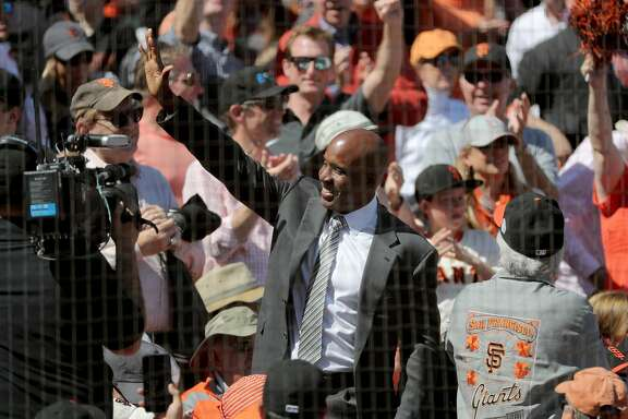 Former GIant Barry BOnds waves to the crowd during the game, as the San Francisco Giants went on to beat the Arizona Diamondbacks 4-1 in their home opener at AT&T Park in San Francisco, Calif. on Mon. April 10, 2017.