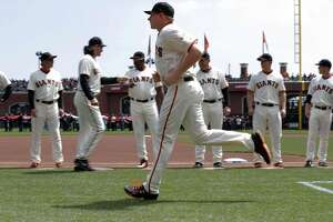 Mark Melancon, the Giants new closer, runs out to the baseline during team introductions before the San Francisco Giants played the Arizona Diamondbacks on opening day at AT&T Park in San Francisco, Calif., on Monday, April 10, 2017.