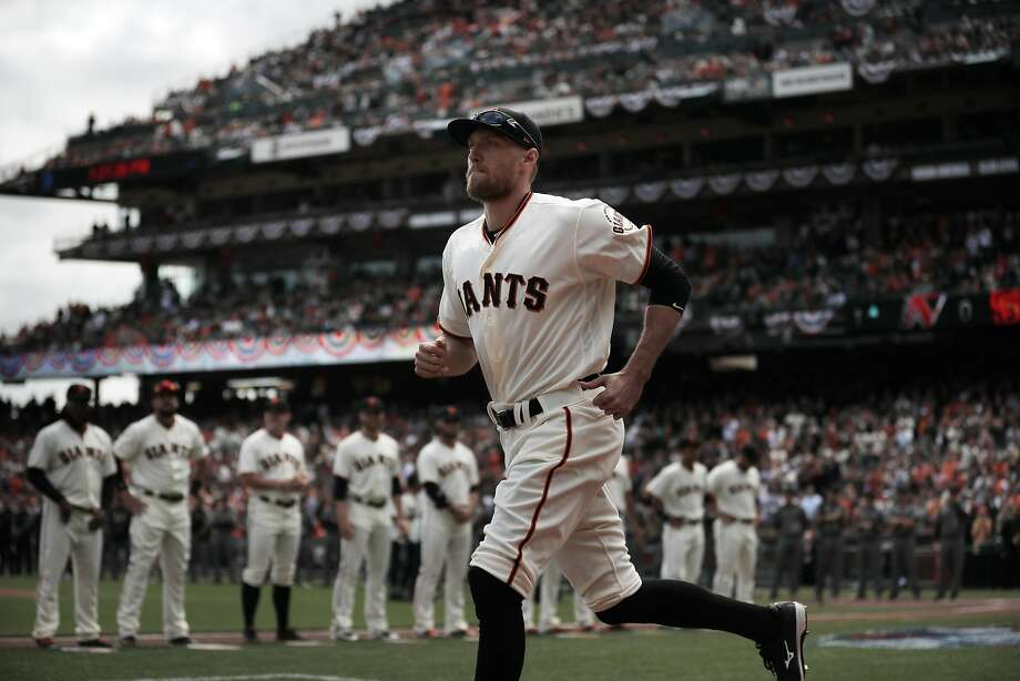 Hunter Pence (8) joins his teammates on the baseline during introductions before the San Francisco Giants played the Arizona Diamondbacks on opening day at AT&T Park in San Francisco, Calif., on Monday, April 10, 2017. Photo: Carlos Avila Gonzalez, The Chronicle