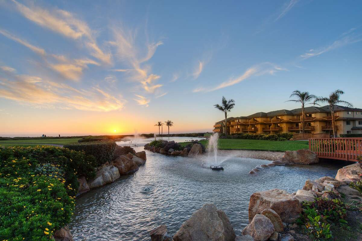Sunset over Monterey Bay adds a glow to the leafy scenery of Seascape Beach Resort in Aptos.