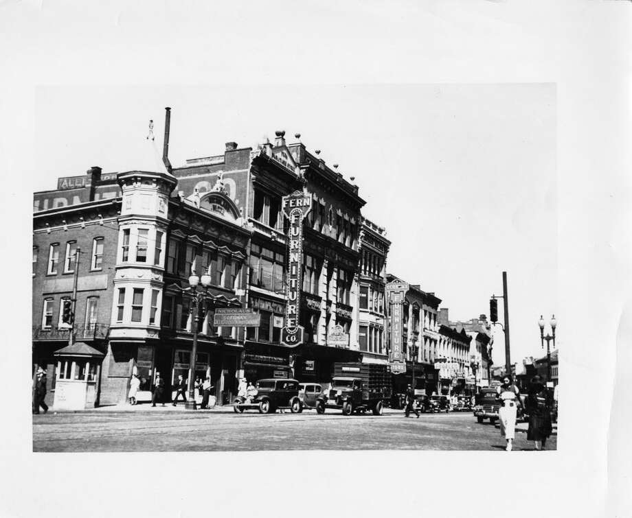 Click to view photos of the demolition of the Olender and Nicholaus buildings in Schenectady.A photo provided by Michael Maloney of the Schenectady County Historical Society shows the State Street, Schenectady, buildings that later became Olender Mattress and its neighbors. From left to right, 264-236 State St., are Nicholaus Restaurant, Fern Furniture, Economy Furniture, The People's Store and Lyon's photo supplies. (Photo courtesy of Schenectady County Historical Society)