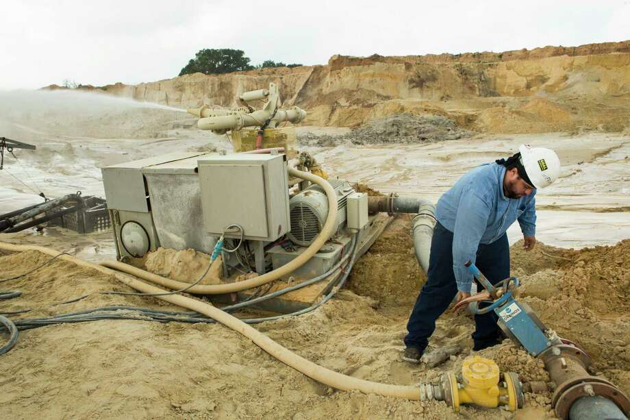 Julio Griffin adjusts the water pressure on a hydro-cannon at the Superior Silica Sands mine in Kosse. Photo: Brett Coomer, Staff / © 2017 Houston Chronicle