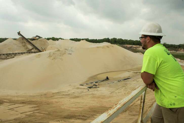 David Heagle, plant manager, looks across the Superior Silica Sands sand mine on Tuesday, March 28, 2017, in Kosse, Texas. Demand for sand is surging as oil and gas production in the Permian Basin is booming again. Not only is the need for more sand on the rise with the increase in oil and gas production in west Texas, but much more sand is being pumed into each well now withi the emerging thesis that more sand equals more oil extracted. ( Brett Coomer / Houston Chronicle )