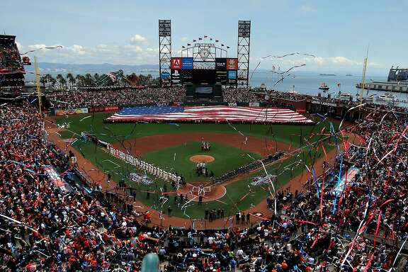 Streamers drop from the upper levels during the national anthem and pregame ceremonies before the San Francisco Giants played the Arizona Diamondbacks on opening day at AT&T Park in San Francisco, Calif., on Monday, April 10, 2017.