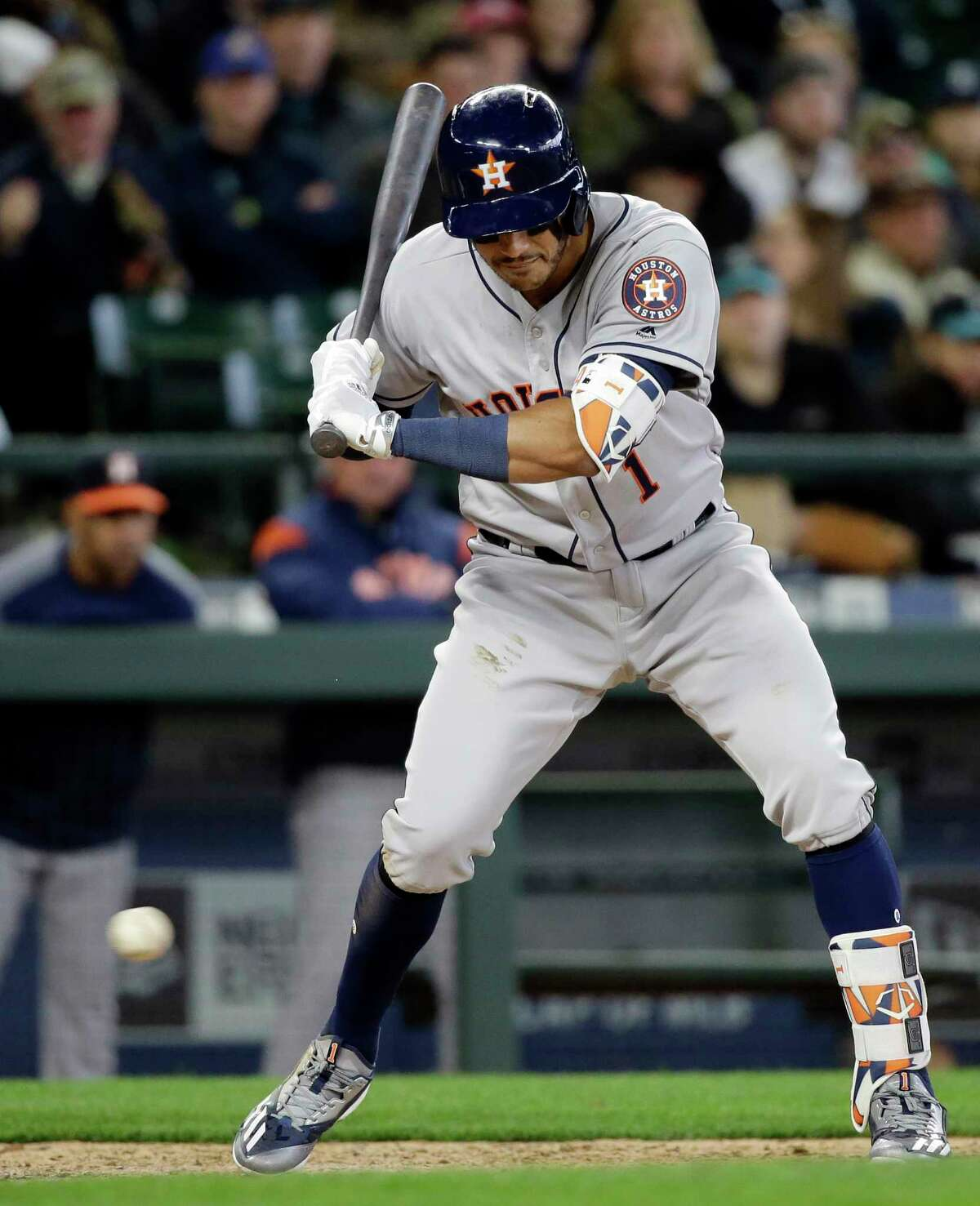 Houston Astros' Carlos Correa watches a called third strike go past against the Seattle Mariners in the eighth inning of a baseball game, Monday, April 10, 2017, in Seattle. The Mariners won 6-0. (AP Photo/Elaine Thompson)