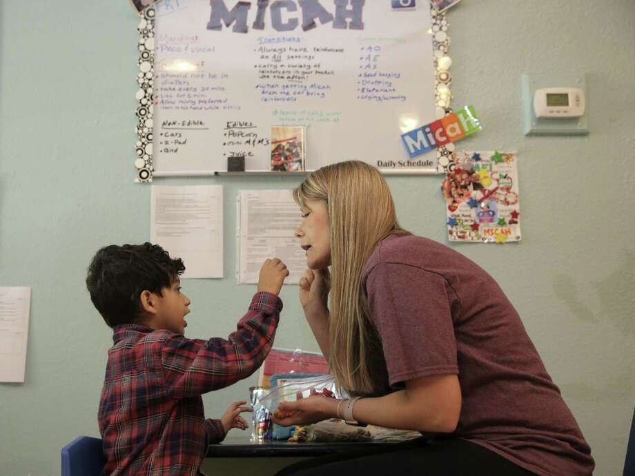 Behavior Advisor Holly Biller works with Micah Rajan, 4, at Texana Center on  Friday, April 7, 2017, in Rosenberg. The Texas Legislature is looking at a bill that would mandate licensure for applied behavior specialists, who often work with autistic people. ( Elizabeth Conley / Houston Chronicle ) Photo: Elizabeth Conley, Staff / Houston Chronicle / © 2017 Houston Chronicle